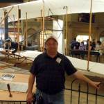Mike Greenshields in front of the Wright Flyer at the Smithsonian