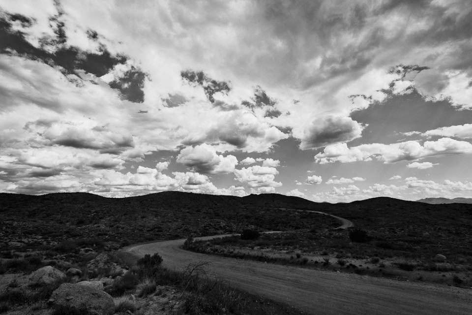 A road less traveled - Arizona dirt road clouds