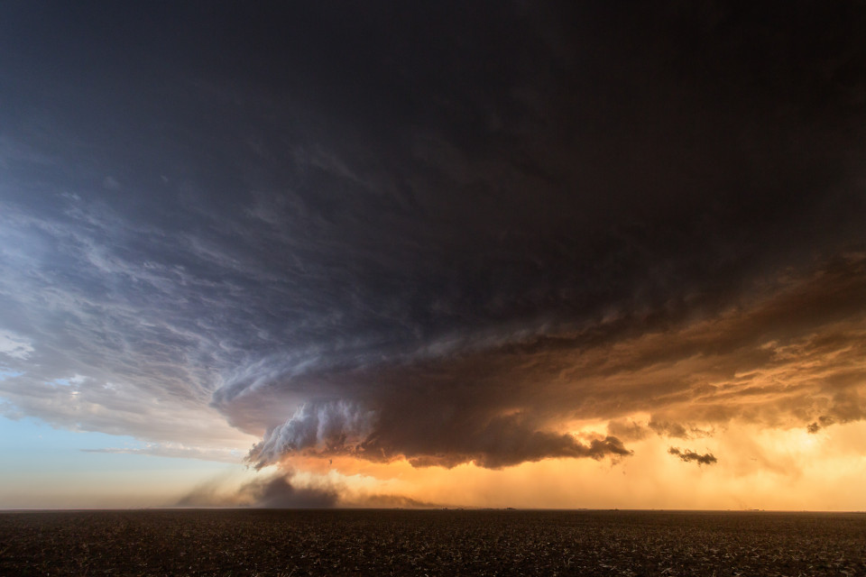 This incredibly photogenic storm near Booker, Texas was like a dust-eating machine. Everything around it seemed to get sucked into the updraft of this stunning supercell. The colors at sunset added to the apocalyptic look of this storm.