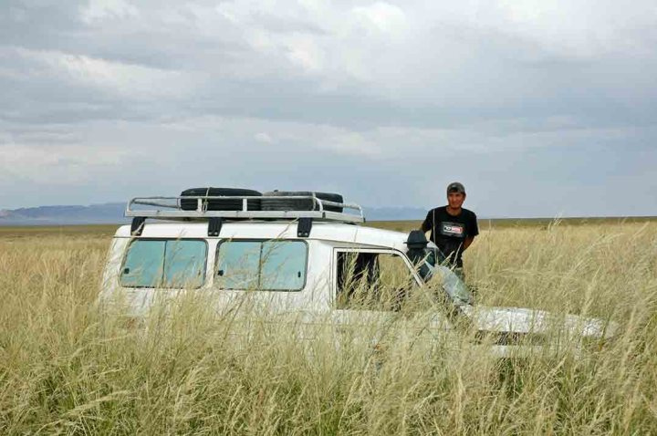 In Mongolia, travel across the wide valleys is often tricky. You can be bogged in a flash, and unlike anywhere else , tall grass can hide the danger.