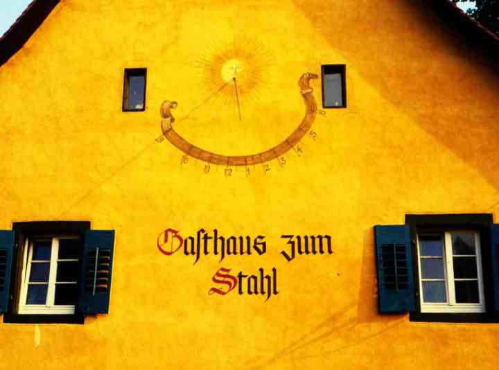 A sundial on the wall of one of the old Freiburg houses.