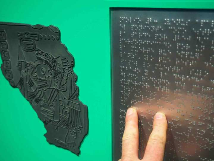 Details of the The Maya Codex of Mexico display for sight-impaired people. Portions of the Codex are presented in relief, and information in Braille.