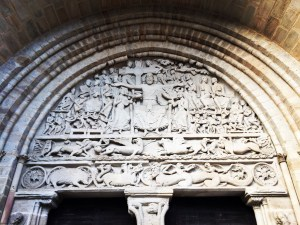 The Triumph of Christ above the door of the church in Beaulieu