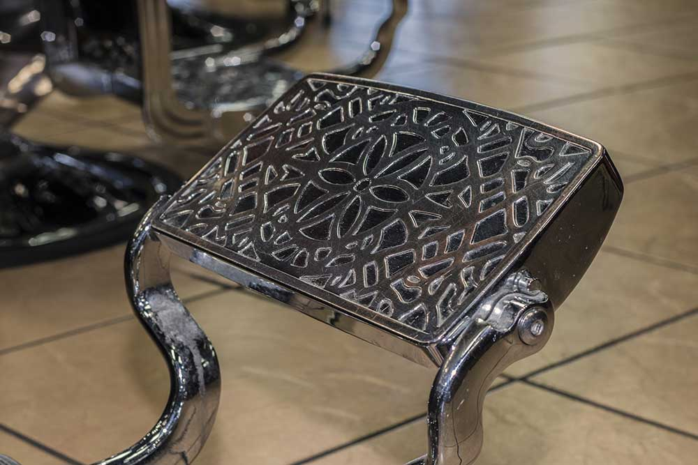 view of barber chairs foot rest