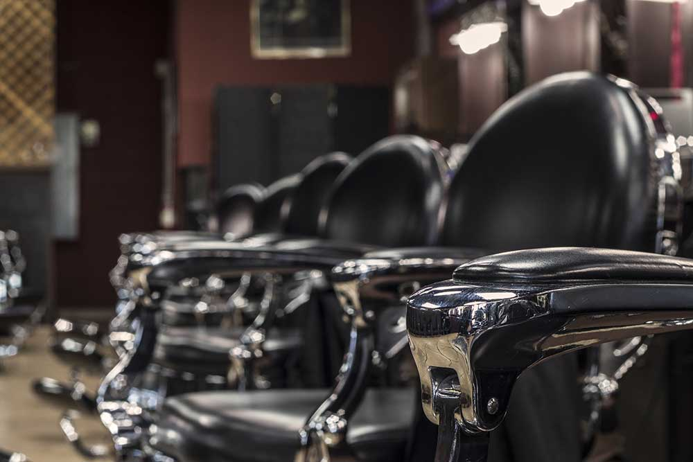 close up of vintage barber chairs