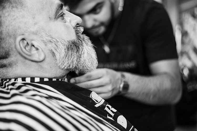 Barber Trimming Beard on Customer