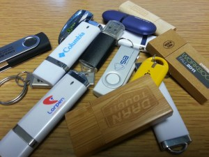 A small sampling of the free flash-drives we have at our house.  Any other good uses for flash-drives?