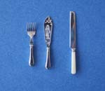 miniature silverware fish servers and bread knife