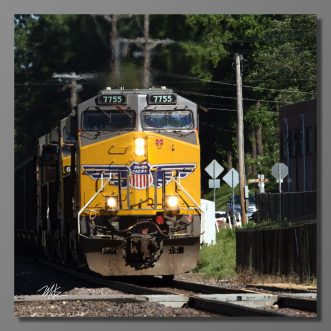 It was June 2017. Patty and I took a ride to Washington Missouri. When I discovered that Amtrak was due to blow through from the east, I set up. First up was an empty coal train. I took the shot. As soon as he passed, a police car loud speaker was ordering me off the tracks. Of course, I complied.
