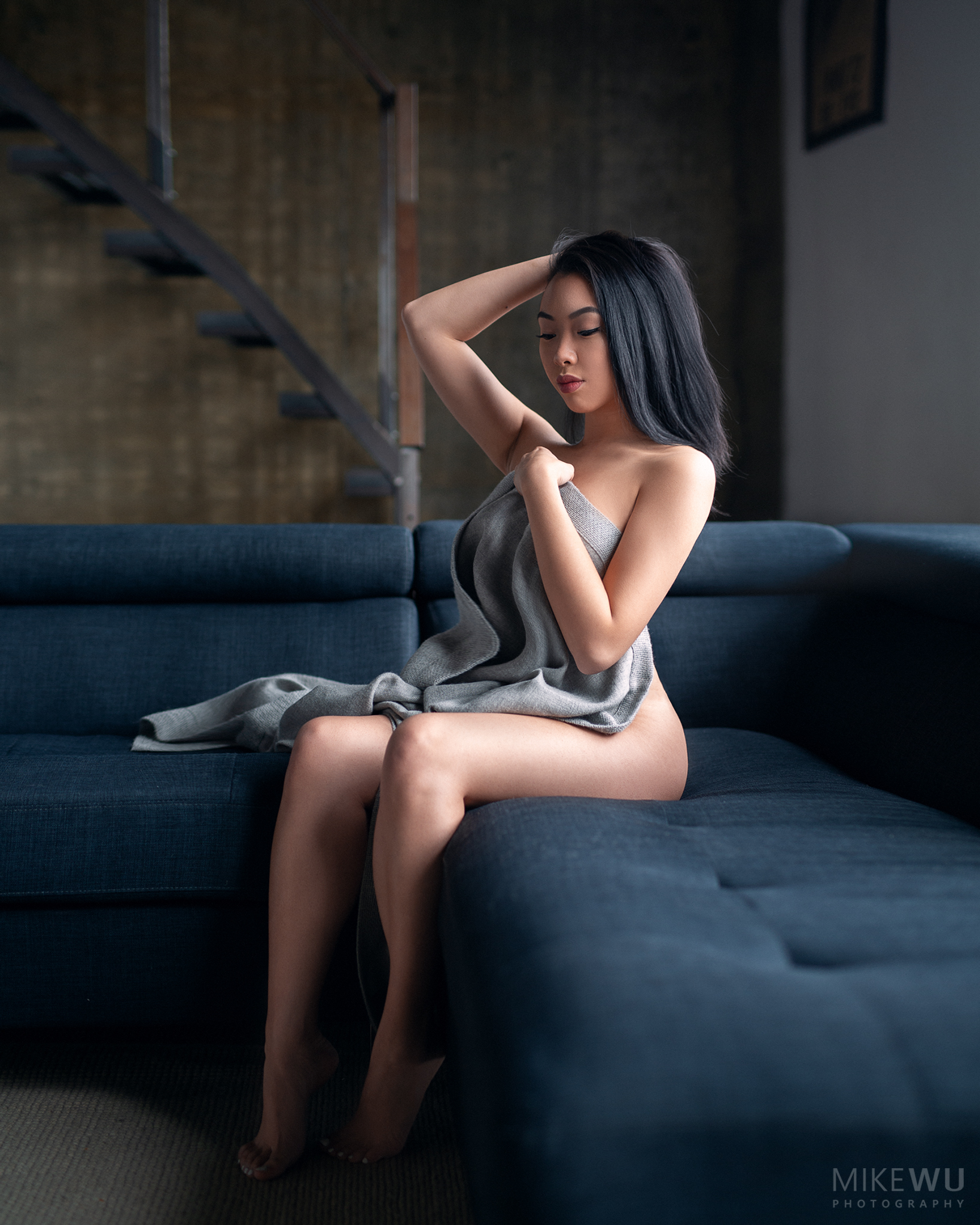 vancouver portrait photographer mike wu, alluring sitting couch indoor studio photography natural 3d beautiful sexy implied asian chinese grey blanket cozy winter mood