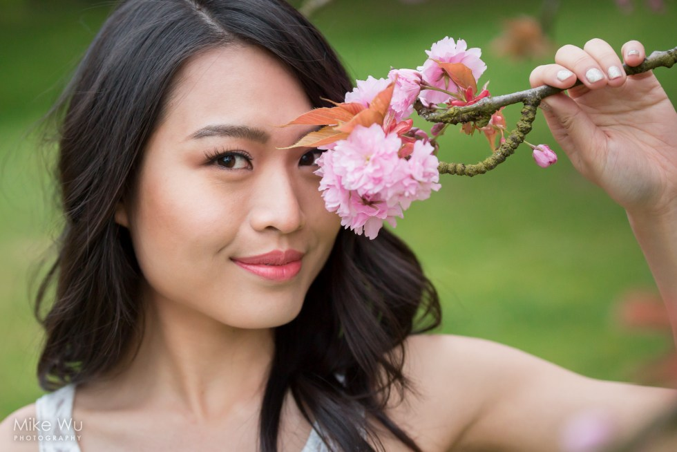 Holding a low sakura branch. Model Joanne Zhou