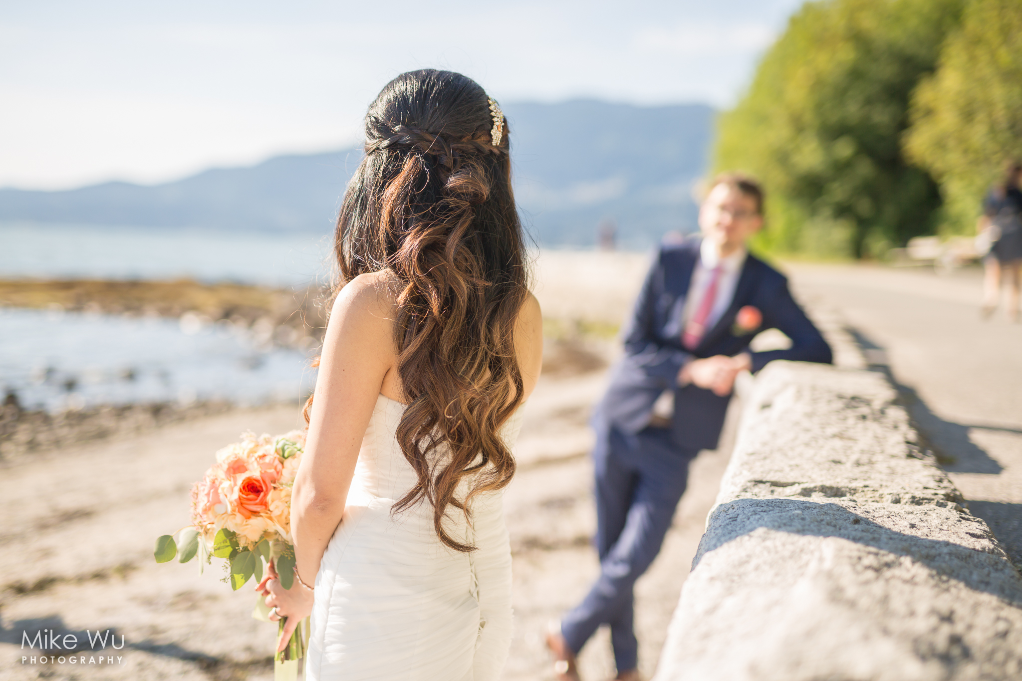 wedding, stanley park, seawall, flowers, teahouse, bouquet, beach, rocks, water, trees, groom, bride, vancouver wedding photographer, couple, look, hair, stone