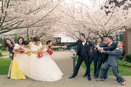 wedding, cherry blossoms, tug of war, groomsmen, bridesmaids, bride, groom, pull, love, vancouver wedding photographer, bridal party