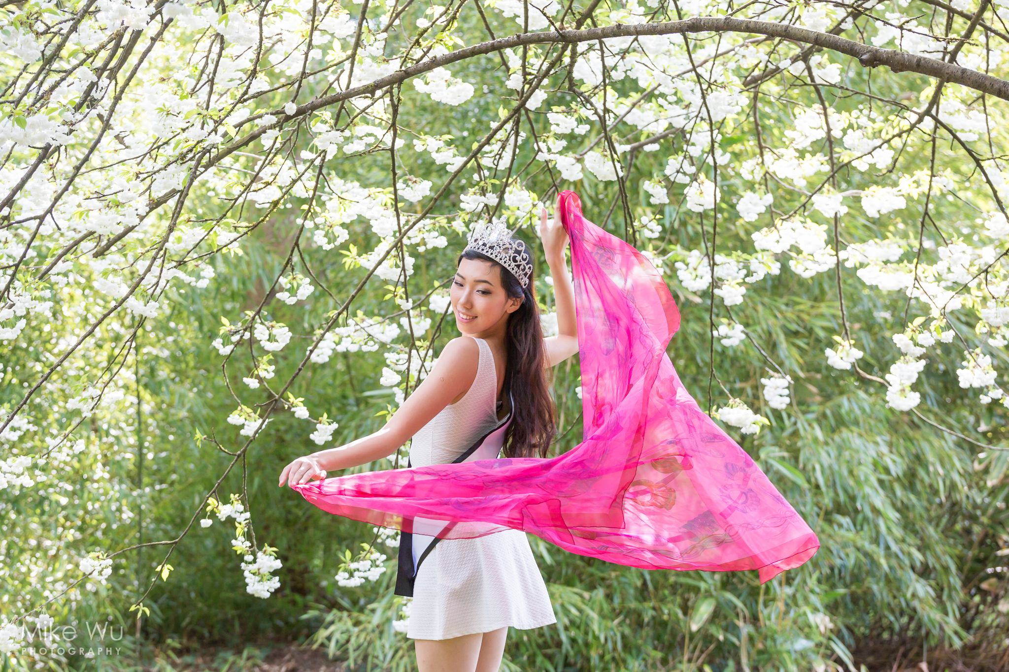 Vancouver Portrait Photographer Mike Wu Photography spring time flowy scarf natural asian beauty pageant winner ariel cao white dress sash flowers tree tiara