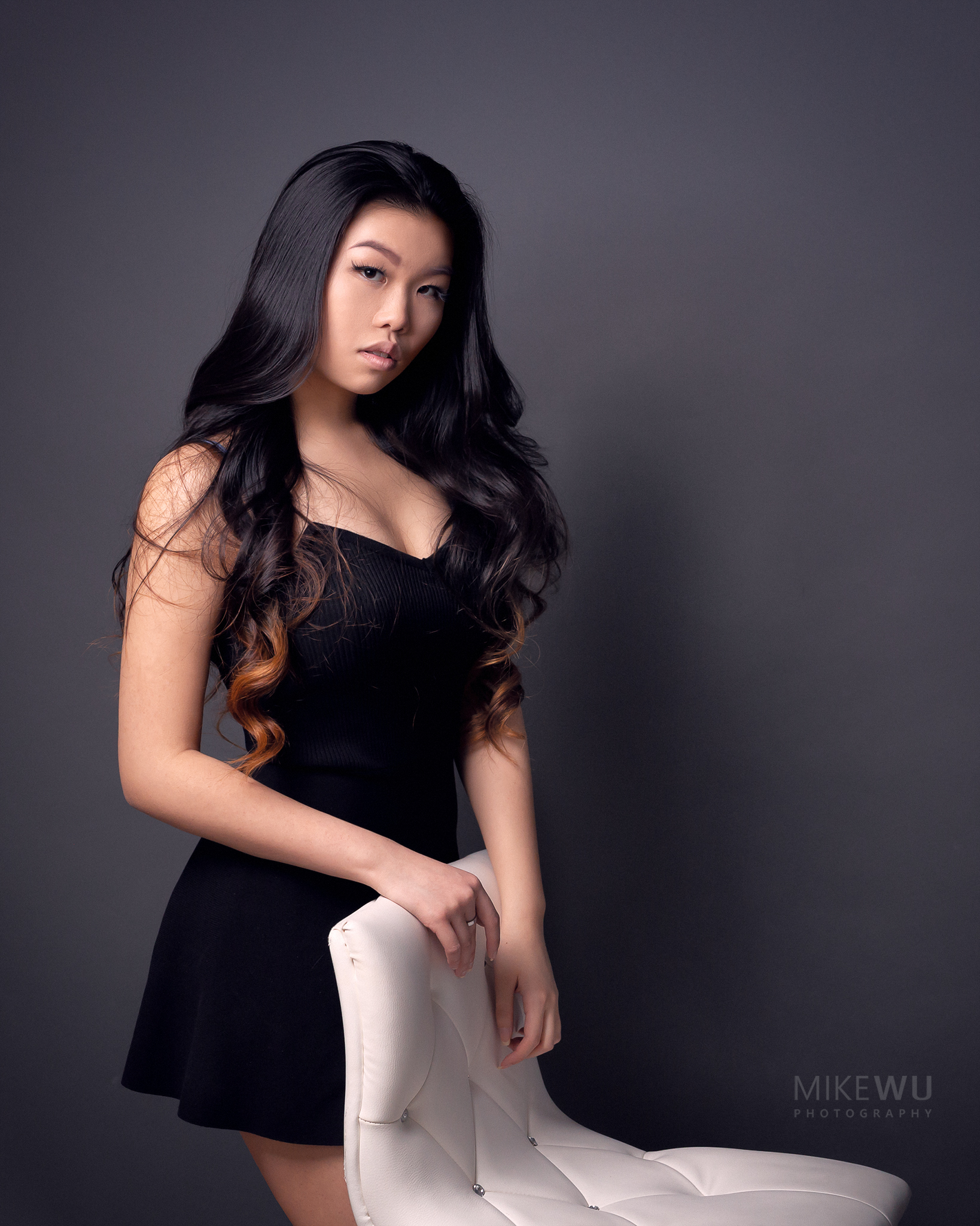 vancouver portrait photographer mike wu traditional indoor studio asian chinese nicole chair beauty wavy hairstyle little black dress