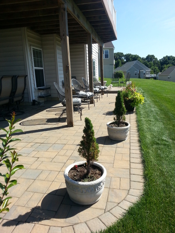 how to build a patio under a deck