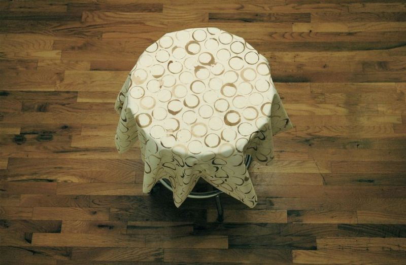 """Marek Milde """"The Same and Not the Same"""" 2009, coffee table, tablecloth, coffee, diameter 37 inches"""