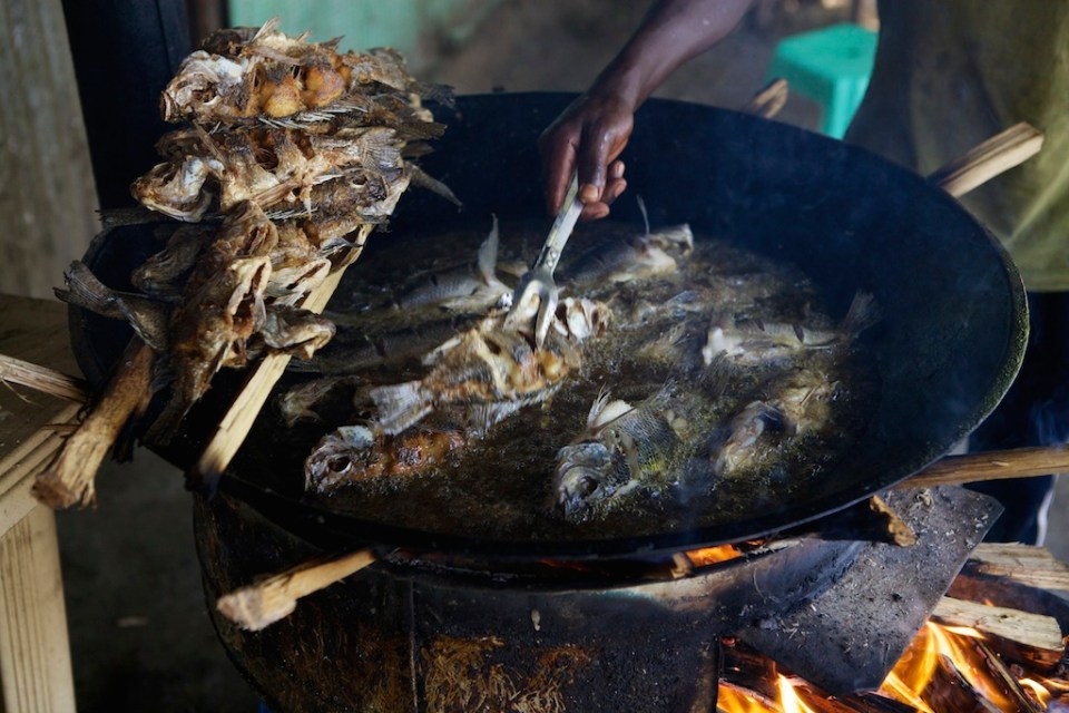 A wok frying fish