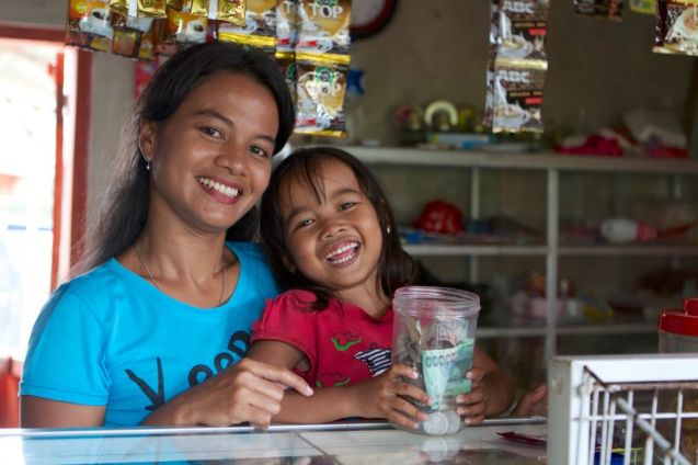 Mother and daughter in their shop, Indonesia