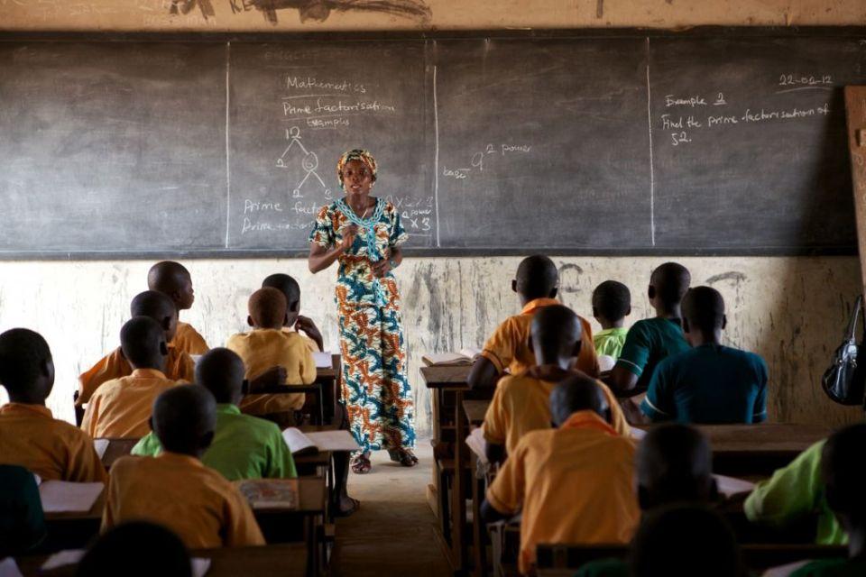 Female teacher teaching a class