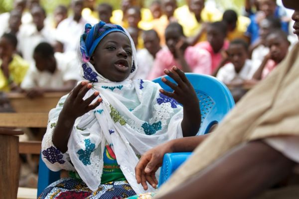 A school girl acting in a play, Ghana.