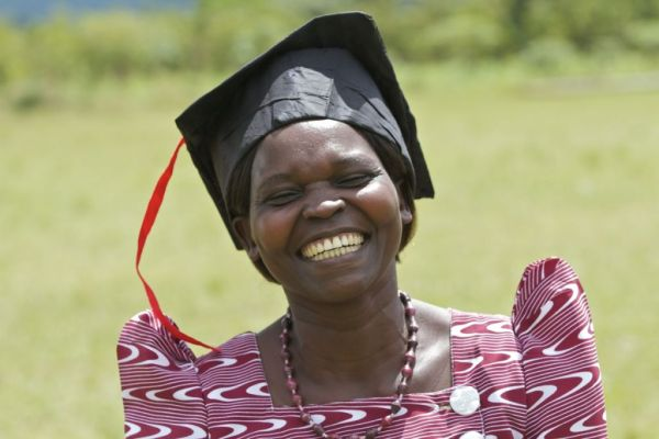 A lady smiling on graduation day, Uganda, Africa