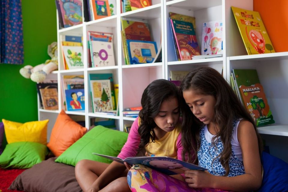 two young girls reading