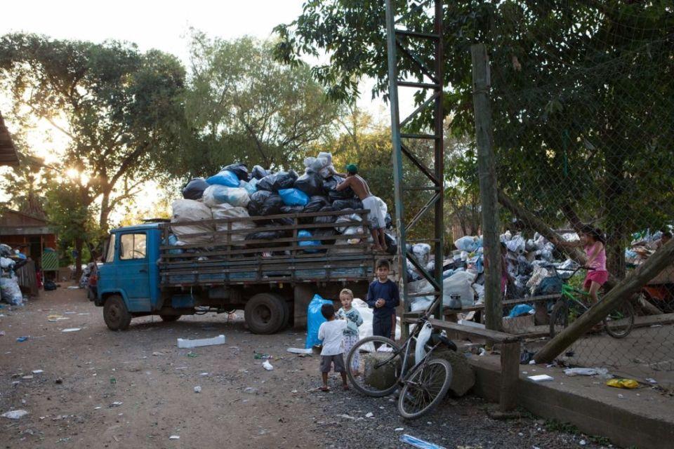 children playing in rubbish