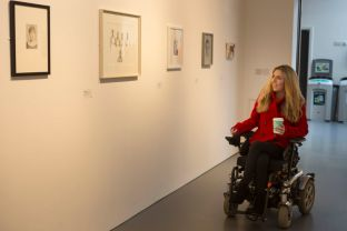 Sophie visiting an art exhibition on campus at University of Bath.