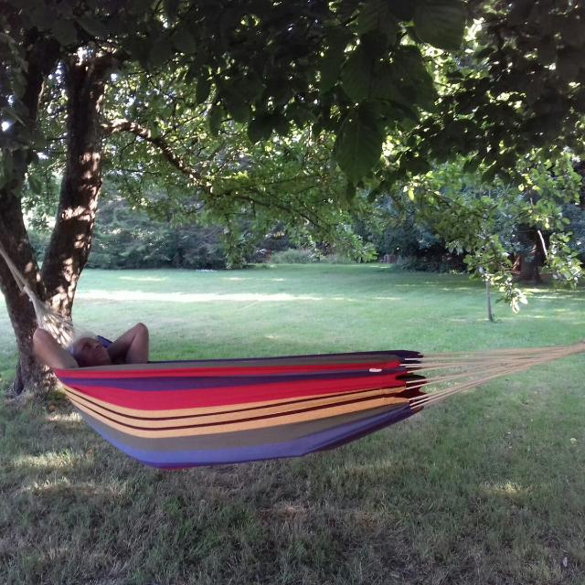 person relaxing in a hammock