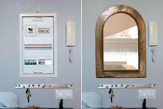 Un espejo para tapar y ocultar el cuadro de luces