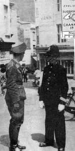 German army officer talking to a policeman in British uniform, St Helier, Jersey. The Channel Islands, part of Great Britain,