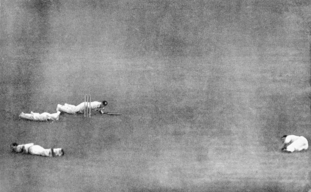 Army v RAF - Lord's Cricket Ground - London - 1944. Players hit the deck as a V1 flying-bomb falls in the vicinity of Lord's; Army's Jack Robertson (batting), RAF's Andy Wilson (wicketkeeper), Bill Edrich (bottom l) and Austin Matthews (r).
