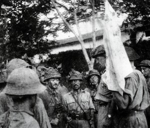 The British surrender Singapore on 15 February 1942. Lieutenant-General Arthur Percival (1887-1966), the British commander, is the tall figure just behind the white flag surrounded by Japanese soldiers