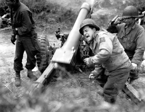 Copy-of-American-howitzers-shell-German-forces-retreating-near-Carentan,-France.-Franklin,-July-11,-1944.