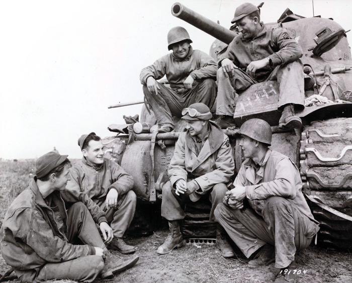 Black and white photograph of Ernie Pyle with the 191st Tank Battalion at Anzio in 1944.