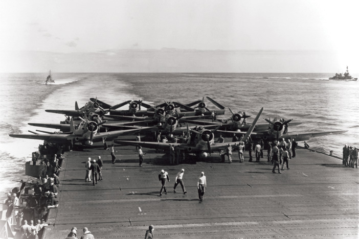 Aircraft are prepared for launching on USS Enterprise  in the early morning, 4 June 1942
