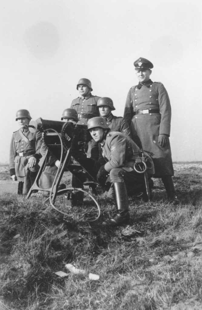 Members of Police Battalion 101 engage in  combat training in the vicinity of Lodz.   Image: United States Holocaust Memorial Museum, courtesy of Michael O'Hara; Bernhardt Colberg.