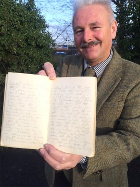 Militaria expert Adrian Stevenson with the Somme diary. Written in pencil by Private Arthur Diggens, it survived for a century in storage. Image: Hansons