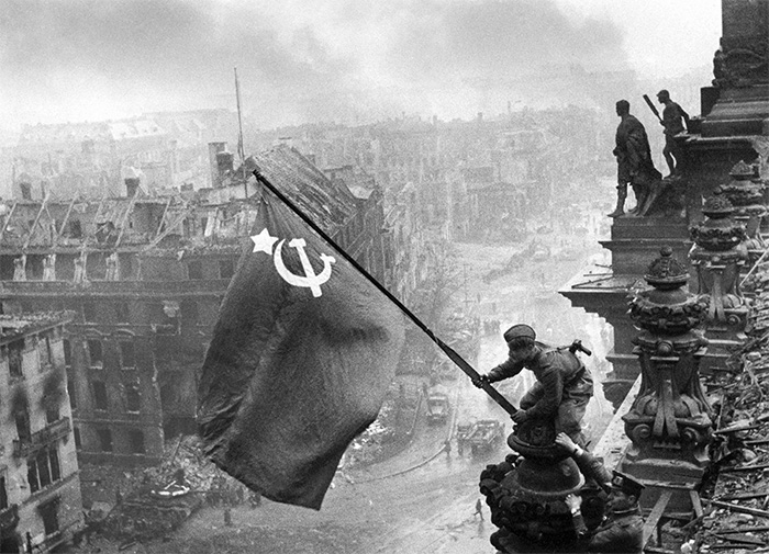 A propaganda image depicting Soviet soldiers raising the Red Flag on the Reichstag. It has since become one of the most recognisable images of the taking of Berlin.