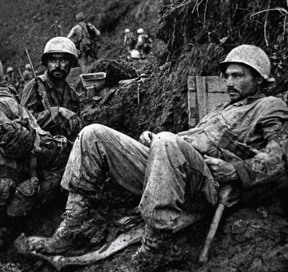 US Marines rest during the ferocious fighting on Okinawa, the first Japanese island to be invaded. How many would die in a land battle for the whole country?