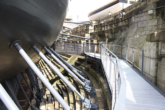 The hull walkway is part of a £35 million restoration project on Nelson's flagship.