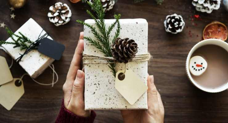 man holding christmas wrapped gift