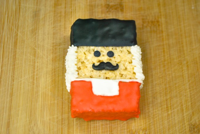 The cutest Nutcracker Soldier Rice Krispie Treat Recipe & Coloring Pages. This is such an easy recipe using store bought rice krispie treats. Great way to make a quick dessert and have fun at the same time! Enjoy the coloring pages and games!