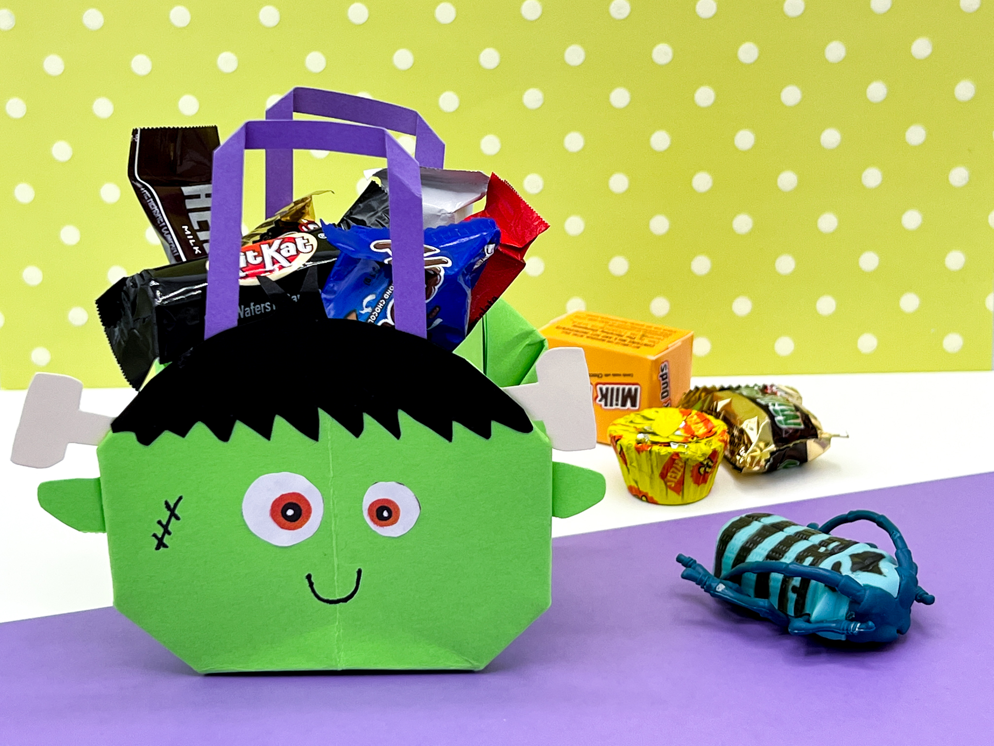 Halloween Origami Craft - Frankenstein Treat Bag Follow this easy photo & video tutorial for a Halloween Origami Craft - Frankenstein Treat Bag. This DIY is great to do with kids OR adults! FREE PDF printable template and instructions & Video!