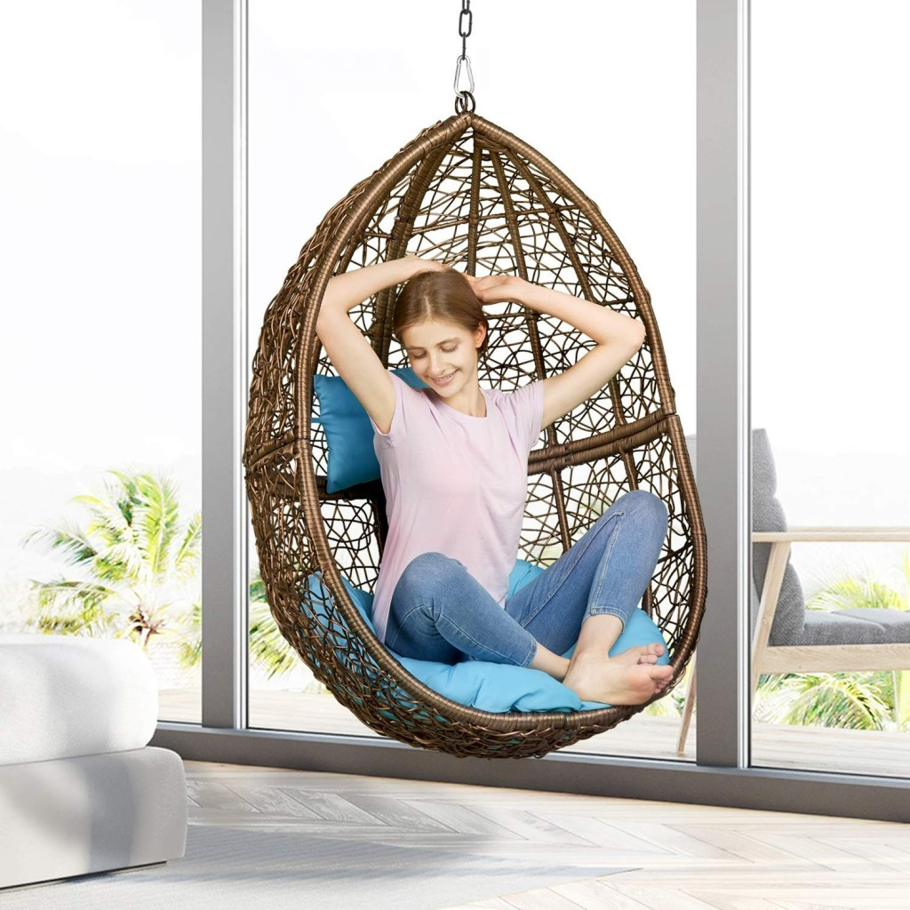 hanging egg chair without stand hanging from the ceiling