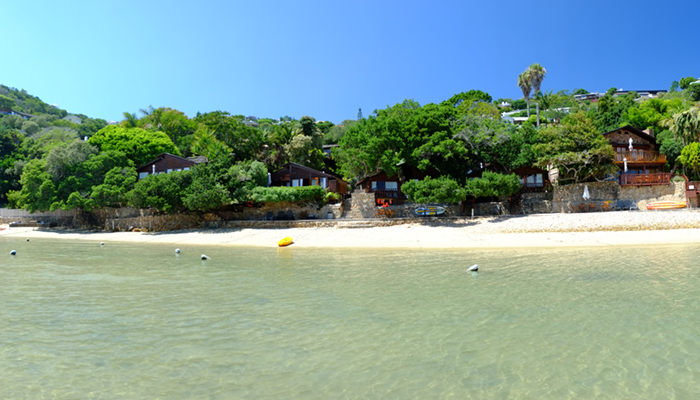 Image of Under Milkwood chalets and beach