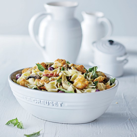 Image of Pasta Salad with Crispy Pancetta, Black Olives, Artichokes, Wild Mushrooms and Blue Cheese Dressing in Le Creuset cookware