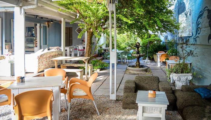 Image of table in garden at The Tin House Café