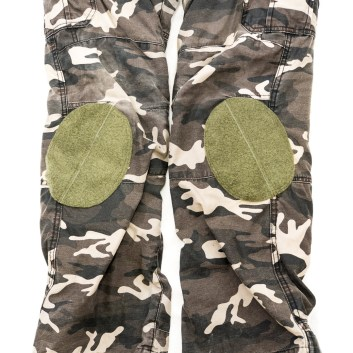 """With the white background and using flash, they might seem out of place. But in """"real life"""" they don't look that odd, and could possibly look like they are for construction knee pads or something of the sort. A camo velcro patch could also be put on top if desired."""